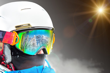 Portrait of skier on dark background.
