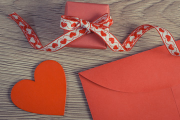Vintage photo, Wrapped gift, red heart and love letter for Valentines Day, copy space for text
