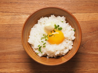 Warm rice with egg york