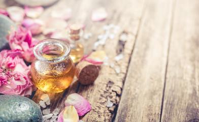 Massage oil, petals flowers and zen stones. Fototapete