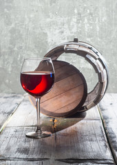 Wineglass and old barrel