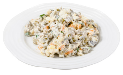 russian salad with mayonnaise on plate isolated