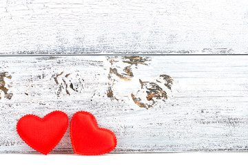 Two red hearts and white wooden plank background
