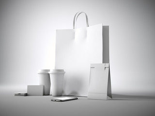 Set of white blank shopping bag, two coffee cups, business cards and generic design smartphone. Light background. 3d render