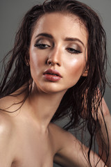 Beautiful young woman with long wet hair