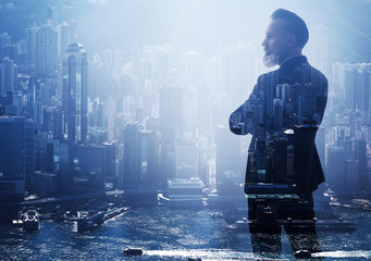 Double exposure photo of a businessman and modern city