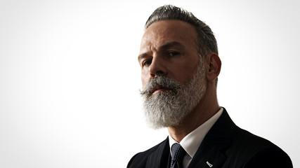 Close-up portrait of bearded gentleman wearing trendy suit. Horizontal