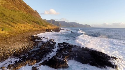 Wall Mural - Kaena Point, Oahu in Hawaii, the north west strip of Oahu and its hiking trail as large waves crash on the beach