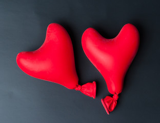 Valentine day concept.red heart balloon on a black slate