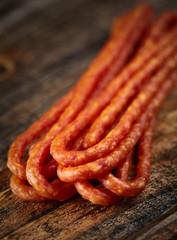 Sticks sausages on wooden board
