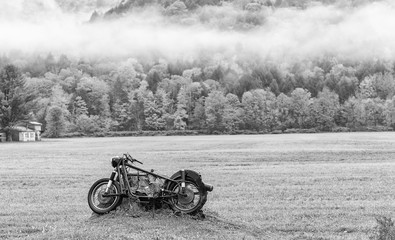Abandoned motorbike on a meadow
