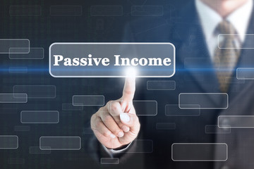 Businessman pressing Passive Income concept button. Can be used in advertising.