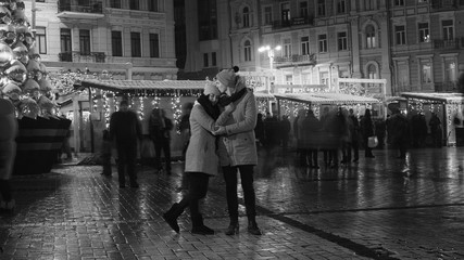Young couple have date in city square
