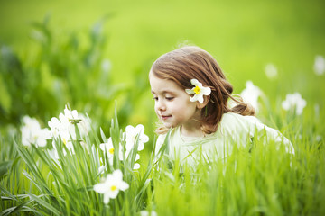 Beautiful Girl smelling flowers