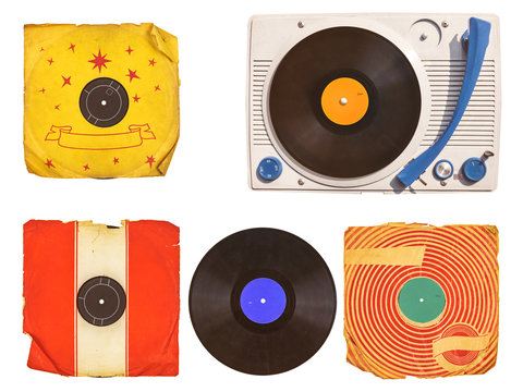 Old turntable player with record albums isolated on white