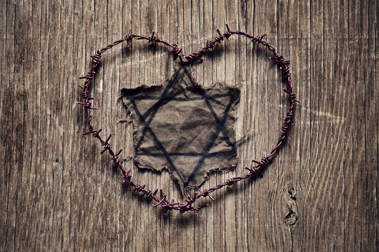 Jewish badge and barbed wire forming a heart