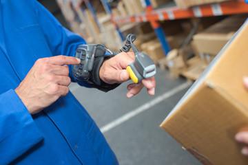 Man using wearble barcode scanner