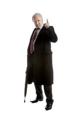 Elderly elegant man with  umbrella  gestures