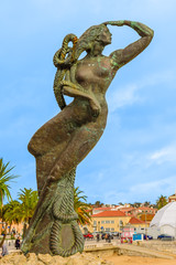 The statue of a mermaid by the sea - the symbol of the resort town of Cascais, Portugal.