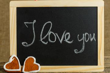 I love you message written on little chalkboard.