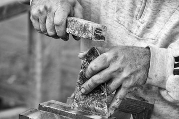Old retired man hands working slate