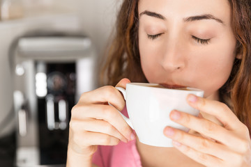 Relaxed woman enjoying her coffee