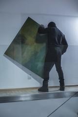 Man stealing piece of art