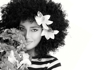 Beautiful Woman Face with Wild Curly Afro Hairstyle with Flowers