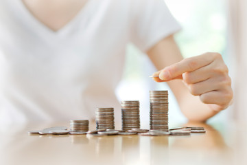 women put coin stack money for money growth concept