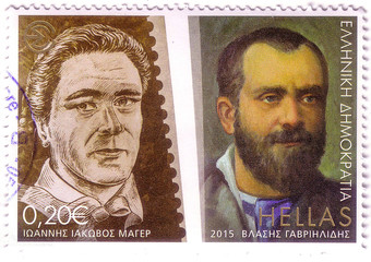 "GREECE - CIRCA 2015: A stamp printed in Greece shows Centenary Journalists Union - Ioannis Iakovos Meyer and Vlasis Gavrielides, commemorative series ""100 years of the founding of ESIEA"", circa 2015."