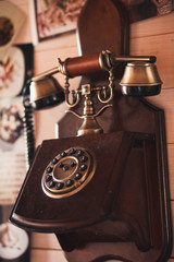 Vintage old phone on the wall in the room