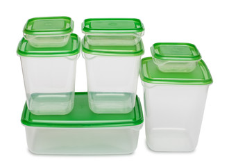 Seven white plastic containers with green caps isolated on white background.