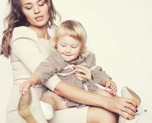 pretty real fashion mother with cute blond little daughter close up smiling happy