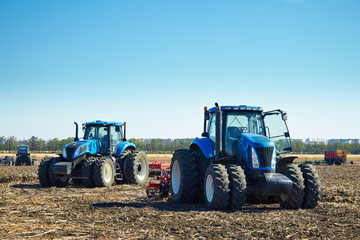 Fototapete - Agricultural machinery on the field