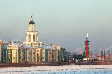 Saint-Petersburg. Russia. Sunset view of The Kunstkamera building and Rostral column
