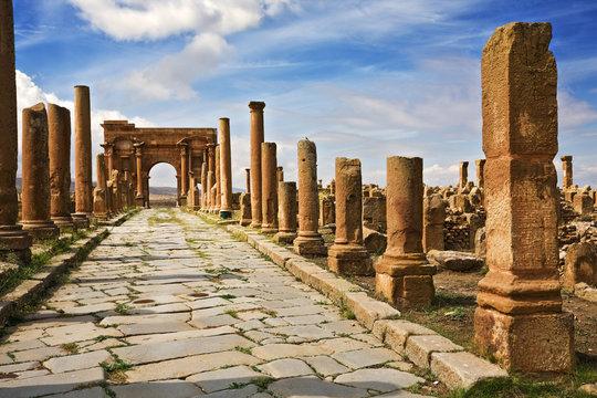Algeria. Timgad (ancient Thamugadi or Thamugas). Decumanus Maximus street and surrounding colonnade terminated Trajan's Arch