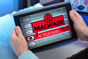 hands of a man looking inbox in tablet with a malware message / man with tablet which see emails and alert message with the word malware
