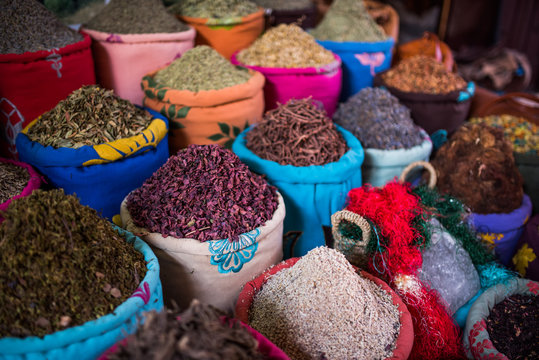 Containers of herbs for sale in the souks of Marrakesh