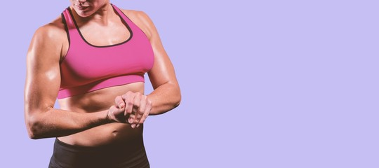 Composite image of muscular woman flexing her arm