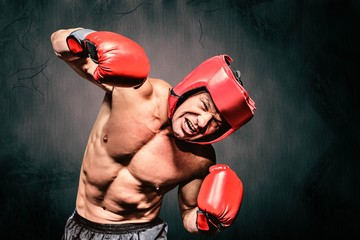 Composite image of aggressive boxer against black background
