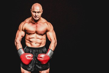 Bald boxer flexing muscles