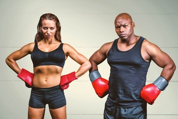 Male and female boxers with hands on hips