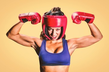 Angry female boxer flexing muscles