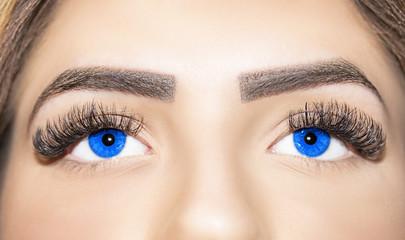 Woman blue eyes with extremely long eyelashes