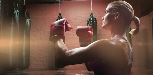 Female boxer with fighting gloves