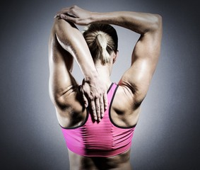 Composite image of muscular woman stretching her arms