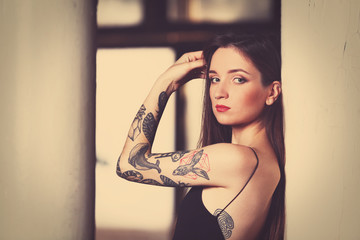 Beautiful young woman with tattoos,  retro stylization