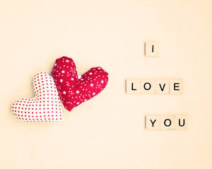 Two vintage stuffed hearts and I Love You message