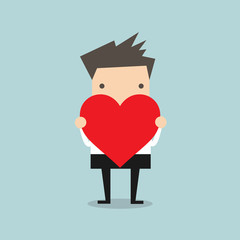 Businessman holding heart shape vector