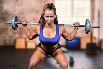 Composite image of portrait confident of woman lifting crossfit